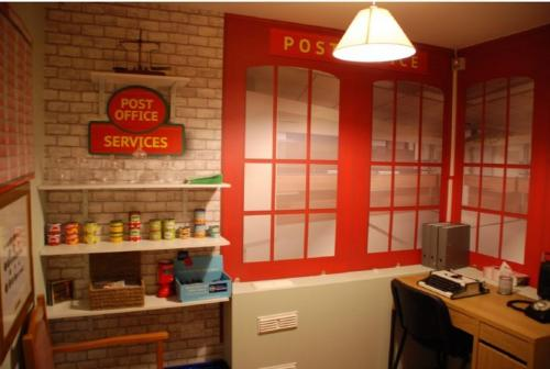 Empty room transformed into a Post Office with shop